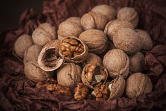 Walnuts on brown paper Royalty Free Stock Photos
