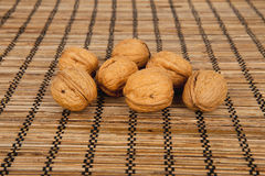 Walnuts on a brown wooden background Stock Images