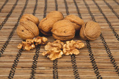 Walnuts on a brown wooden background Stock Photo