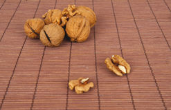 Walnuts on a brown wooden background Royalty Free Stock Images