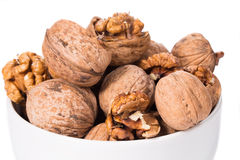Walnuts bunch in bowl. Stock Photo