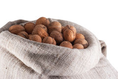 Walnuts in burlap bag Stock Images