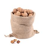 Walnuts in burlap bag Royalty Free Stock Images