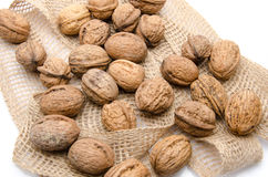 Walnuts on burlap Royalty Free Stock Images