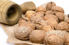 Walnuts on burlap with an old nutcracker Royalty Free Stock Photo