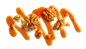 Walnuts and caramel sauce royalty free stock photo