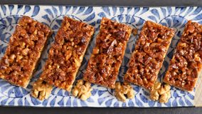 Walnuts caramelized on shortcrust pastry. stock images