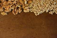 Walnuts and cedar pine nuts. On wooden background Stock Photo