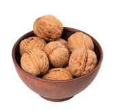 Walnuts in ceramic bowl Stock Images