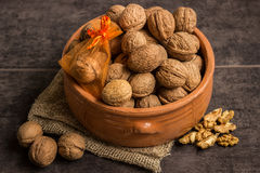 Walnuts in a ceramic bowl and a small gift Stock Photo
