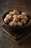 Walnuts in a ceramic bowl Stock Photos