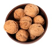 Walnuts in ceramic bowl. Top view. Stock Photo