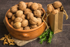 Walnuts in a ceramic pot on a dark background Royalty Free Stock Photo