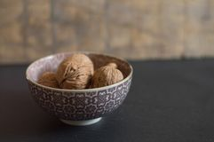 Walnuts in a chinese cup. A cup of walnuts which are fruits with antioxidant properties. These fruits contain high amounts of omega-3 fatty acids and are rich in royalty free stock photo