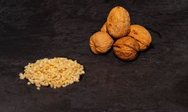 Walnuts with chopped almonds royalty free stock photos