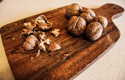 Walnuts on chopping Stock Photo