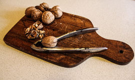 Walnuts on chopping Stock Photography