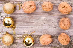 Walnuts and christmas balls backgrounds Royalty Free Stock Photography