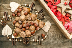 Walnuts with christmas decorations and red ribbons Royalty Free Stock Images