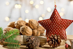 Walnuts with Christmas star. Walnuts with red christmas star Stock Photos