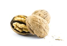 Walnuts - close up shot cracked in two pieces on a white background Royalty Free Stock Images