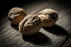 Walnuts close-up on wooden background Stock Image
