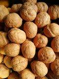 Walnuts. Closeup to lots of Walnut kernels and whole walnuts .Full background Royalty Free Stock Photos