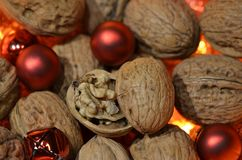 Walnuts combined with red Christmas balls Stock Image
