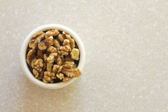 Walnuts in a Container on a Kitchen Countertop, Positioned Left Royalty Free Stock Photography