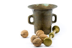 Walnuts and copper mortar. On isolated white background Royalty Free Stock Photos