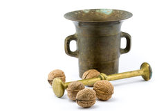 Walnuts and copper mortar. On isolated white background Stock Image