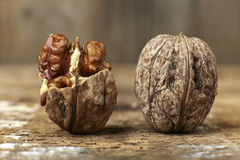 Walnuts cracked open on a wooden table Stock Photography