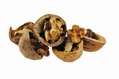 Walnuts and a cracked walnut Royalty Free Stock Image
