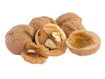 Walnuts and a cracked walnut Royalty Free Stock Images