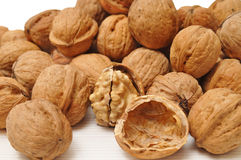 Walnuts. And a cracked walnut Royalty Free Stock Photography
