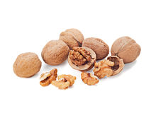 Walnuts and a cracked walnut isolated on white Stock Photo