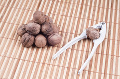 Walnuts and Cracker. On bamboo background Stock Image