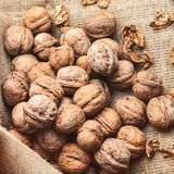 Walnuts on craft loft cloth. Lots of walnuts on craft loft cloth Royalty Free Stock Photography