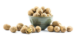 Walnuts in a cup on a white background Royalty Free Stock Photography