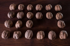 Walnuts on a dark background, conceptual photography. Walnuts lie in a row in a heap, an extra player, an interesting idea royalty free stock photos