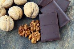 Walnuts and dark chocolate Stock Image
