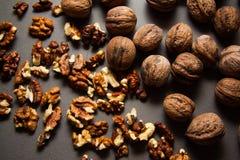 Walnuts on dark grey background Stock Photo