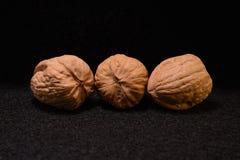 Walnuts on dark Stock Photo