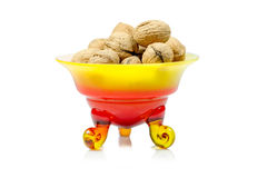 Walnuts in a decorative bowl on white background Royalty Free Stock Image