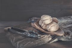 Walnuts with a device for nuts on a wooden background. Copy space.  stock photo