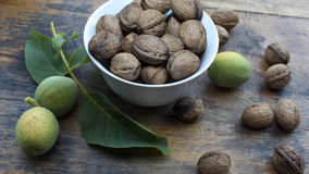 Walnuts on display in bowl and on wooden table. Walnuts 005 on display in bowl and on wooden table. High resolution image Stock Photography