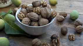 Walnuts on display in bowl and on wooden table. Walnuts 005 on display in bowl and on wooden table. High resolution image Royalty Free Stock Photography