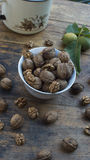 Walnuts on display in bowl and on wooden table. Walnuts 005 on display in bowl and on wooden table. High resolution image Stock Images