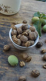 Walnuts on display in bowl and on wooden table. Walnuts 005 on display in bowl and on wooden table. High resolution image Stock Photo