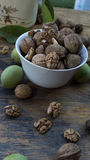 Walnuts on display in bowl and on wooden table. Walnuts 005 on display in bowl and on wooden table. High resolution image Royalty Free Stock Photo